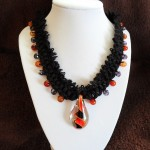Red and black glass drop with natural carnelians on black velvet cord