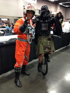 Rebel Pilot and Unicycle riding, bagpipe playing Darth Vader
